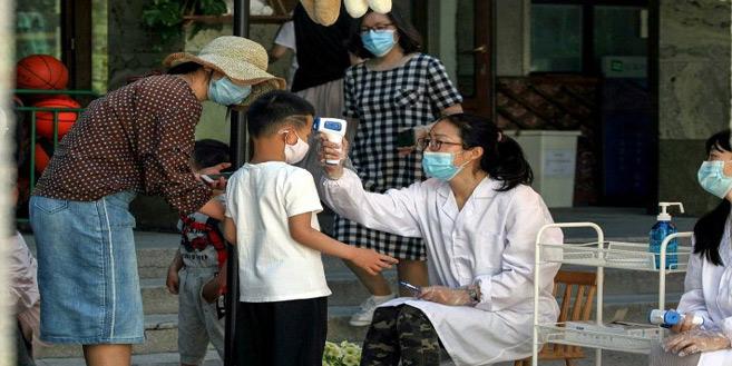 Pékin se remet peu à peu sous cloche — Coronavirus en Chine
