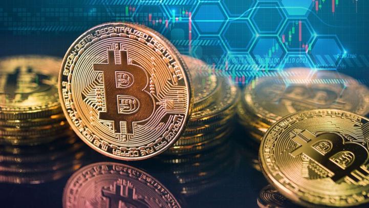 Le Bitcoin atteint un nouveau record de plus de 61.000 Dollars