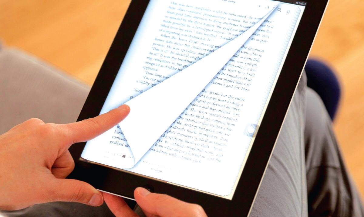 Une liseuse qui tourne les pages du livre numérique